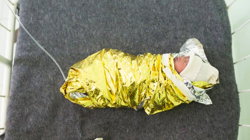 A premature baby is wrapped in a recovery blanket in Gambella hospital, Gambella