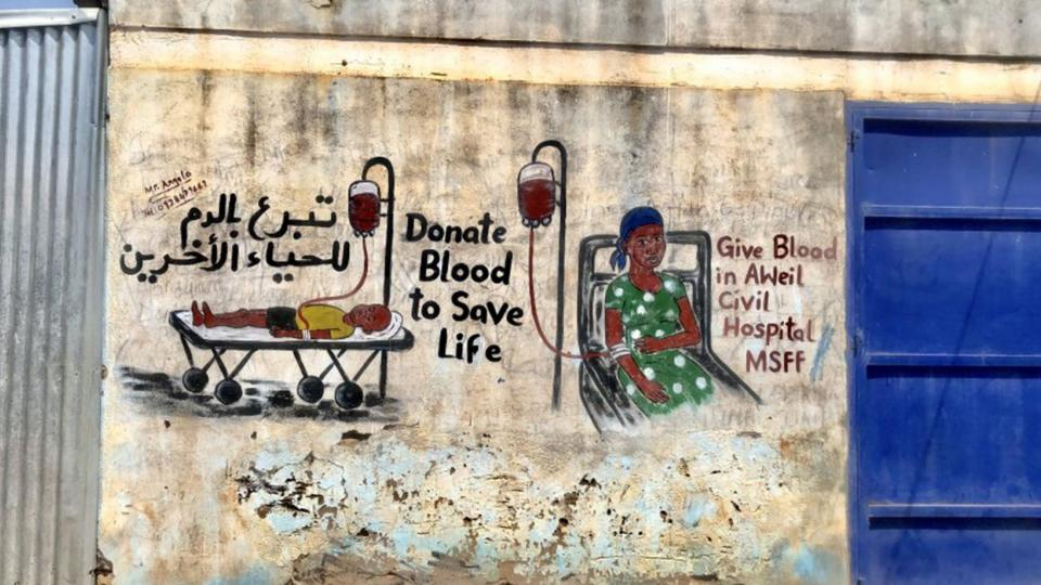 A painting in Aweil's market created to promote giving blood donations during malaria season